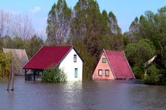Flood. House sunk during the flood stock photos