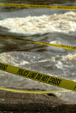 Flood. Ed river with police tape to protect the public. Police tape in the foreground is in sharp focus Stock Images