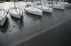 Flood. Sailing ships in the marina of Nyborg, Denmark a stormy evening in November with flood. The quay is covered with water. Photo captured from my balcony Stock Image