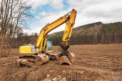 Flood adjustments river. Work on the riverbed. Excavator on the work to strengthen the shoreline of the river. Royalty Free Stock Image