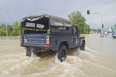 Flood Alert. Malaysian police truck on duty. Heavy rains cause irregular flood in Rantau Panjang, Malaysia - Thai borders Stock Photography