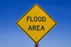 Flood Area Sign. Flood area road sign with blue sky background royalty free stock image