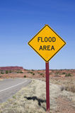 Flood Area Sign. Vertical image of flood area sign in the desert royalty free stock photo