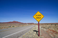 Flood Area Sign in Desert. Horizontal image of flood area sign and road in the Utah desert royalty free stock photos