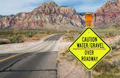 Flood Area Warning Sign. A sign in southern Nevada warns of a flash flood area ahead stock photo
