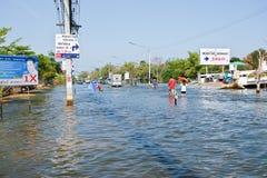 Flood in Bangkok, Thailand. Bangkok, Thailand - November 16: The road is flooded and hard to roaming through November 16, 2011 at Pathum Thani. Bangkok, which is Royalty Free Stock Photo