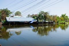 Flood in Bangkok, Thailand. Bangkok, Thailand - November 16: The house is flooded canal at November 16, 2011 at Pathum Thani. Bangkok, which is the worst flood Stock Photos