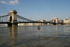 Flood in Budapest Hungary 2006. Flood in Budapest, Hungary in 2006. There is a road flooded by the river Danube. Only a traffic sign and the most famous and the Royalty Free Stock Photos
