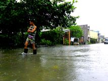 Flood caused by typhoon Mario (international name Fung Wong) in the Philippines on September 19, 2014. Residents of Cainta, Rizal walk through flood waters stock photography
