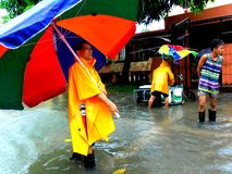 Flood caused by typhoon Mario (international name Fung Wong) in the Philippines on September 19, 2014. Residents of Cainta, Rizal walk through flood waters stock photos