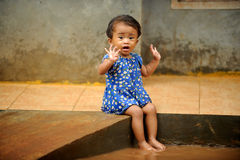 Flood, Child Playing. Flood in Indonesian village Stock Photos