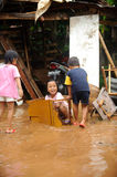 Flood, Children Playing. Children having fun playing during a flood Royalty Free Stock Photos