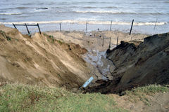Flood Damage 01. Damaged caused by rain. The water cut a hole into the cliff side Royalty Free Stock Photography