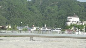 Flood damage on a bridge over the Inn River with the city Kufstein in the background Austria