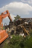 Flood Damaged home being torn down in New Orleans.