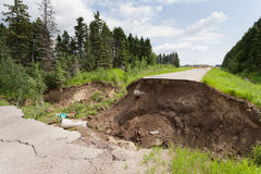 Flood damaged washed out road Royalty Free Stock Photos
