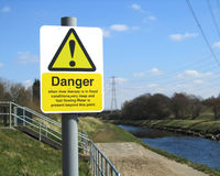 Flood Danger Sign. MANCHESTER, ENGLAND, APRIL 6: Warning sign next to the River Mersey in Didsbury, Manchester on April 6 2013. The sign is next to a sluice gate Stock Photography