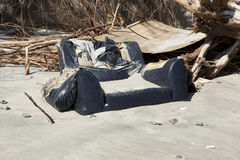 Flood debris buried by sand Royalty Free Stock Image