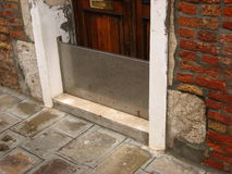 Flood defence. A common sight in Venice - metal barriers to protect doors from the acqua alta Royalty Free Stock Photo