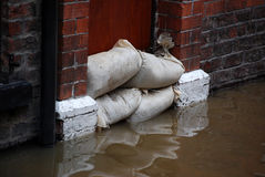Flood defences. Sandbag barrier in doorway of flooded street in York royalty free stock image