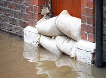 Flood defences. Sandbag barrier in doorway of flooded street in York royalty free stock photo