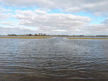 Flood in fields. Lithuanian spring landscape Stock Photography