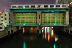 Flood gate. Typical huge flood gate in Tokyo metropolis with scenic night illumination royalty free stock photos