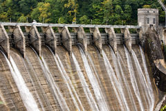 Flood gates of a Dam. The flood gates of a dam just starting to open Royalty Free Stock Images
