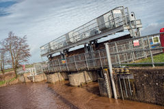 Flood Gates On High Swollen River Stock Images