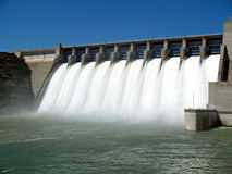 Flood gates open. Water rushing over flood gates of a dam stock photos