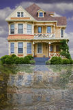 Flood House. House depicted in a flood with water and reflection stock images