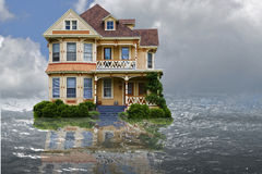 Flood House. House depicted in a flood with water and reflection Royalty Free Stock Image