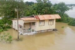 Flood House in Pasir Mas. A house in flood . This shot was taken in Pasir Mas, Kelantan Malaysia on end of November 2011 Stock Photos