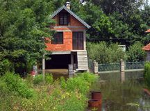 Flood, house surrounded by water. House surrounded by water at spring at Serbia royalty free stock photography