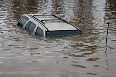 Flood Insurance Car. Car swamped in flood water. Perfect for motor vehicle insurance theme royalty free stock images