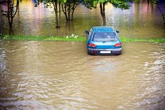 Flood insurance need before. Flooded car on parking lot in city Royalty Free Stock Photography