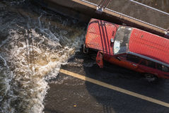 Flood insurance. With old red car on express way Royalty Free Stock Images