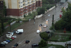 The flood inundated a street in Odessa. ODESSA, UKRAINE - Jule 16. Cars attempts to go along the steet through flood waters after a heavy rain on Jule 16, 2012 Royalty Free Stock Photography