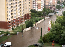 The flood inundated a street in Odessa. ODESSA, UKRAINE - July 16. Cars attempts to go along the steet through flood waters after a heavy rain on July 16, 2012 Stock Image