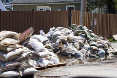 Flood in Laval West, Quebec. May 16th 2017. It`s now time for cleaning up after the worst flood in over 100 years, in Laval-West, Quebec. Sand bags, used to Stock Photos
