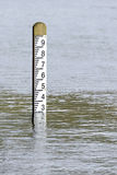 Flood level water depth marker post Stock Photos