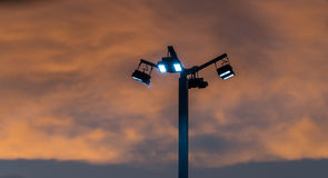 Flood light with cloud. Flood light with beautiful sky and dark cloud Royalty Free Stock Photo