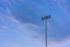 Flood light tower with blue sky. Flood light tower with blue cloudy sky Stock Images