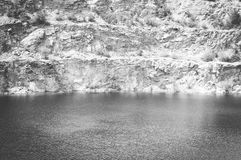 The Flood and the Mine things. Are not compatible, like water and stone, which is grinded Royalty Free Stock Photo