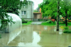 Flood in Poland - Silesia, Zabrze,river Klodnica. An one among many is describing taking effect of heavy rains which are falling down from a few days above south Royalty Free Stock Photos
