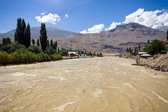 Flood in populated area. In Pamir Stock Photo