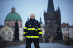 Flood in Prague. PRAGUE - JUNE 2: Fireman Vaclav Kratochvil on Charles Bridge. The Czech Capital - Prague is on high alert as a swell of floodwater moves in from royalty free stock photography