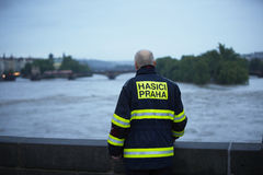 Flood in Prague. PRAGUE - JUNE 2: Fireman Vaclav Kratochvil on Charles Bridge. The Czech Capital - Prague is on high alert as a swell of floodwater moves in from royalty free stock photos