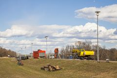 Flood protection dam under construction. On river Danube with crane and genset stock images