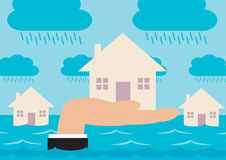Flood Protection. Houses on a flood plain, with a hand raising up the house in the foreground. A metaphor regarding home insurance and flood protection Royalty Free Stock Images